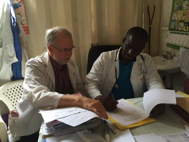 Dr Kigayi signing an MoU with AusHEAL to commence his scholarship in Anaesthesia training