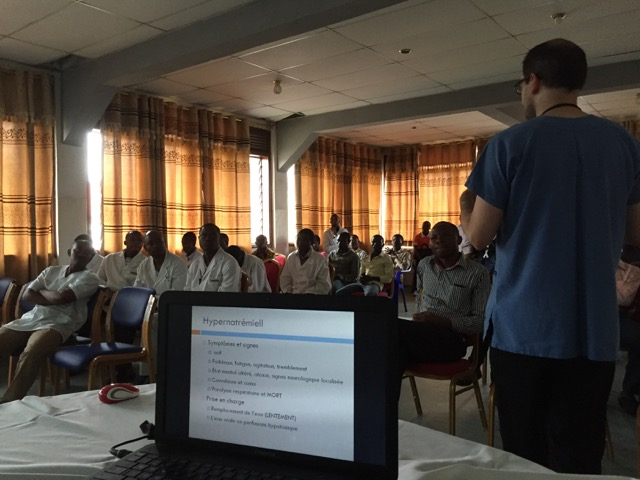 Ryan Williams teaching doctors in French (note the french translation on the screen)