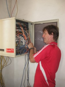 #10 1B Paul Bakes working on a HEAL Africa server