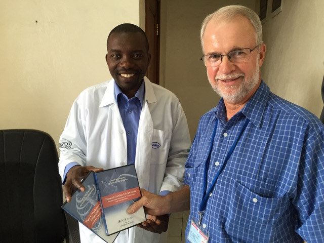 Dr Albin receiving Echocardiology CD's